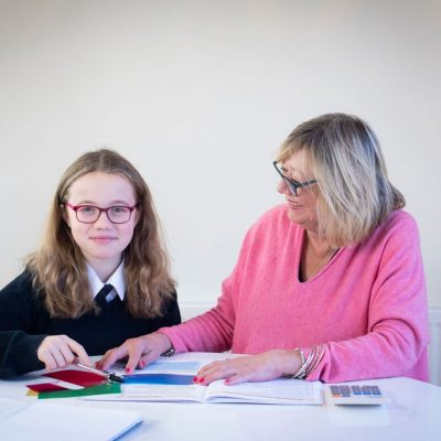 Teacher helping child read with dyslexia